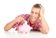 Man putting five euro in piggy bank Royalty Free Stock Photo