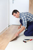 Man putting floating floor Royalty Free Stock Images