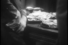 Man putting food from buffet in his pocket stock footage