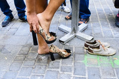 Man putting on high heels shoes Royalty Free Stock Photo