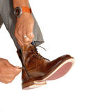 Man putting on his shoes. Royalty Free Stock Images