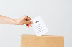 Man putting his vote into ballot box on election Stock Photos
