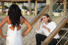 Man putting his woman on hold Stock Image