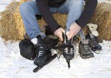 Man putting on ice skates royalty free stock image