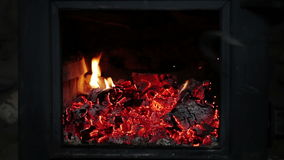 Man putting Log Woods inside a Fireplace