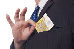 Man putting money in his pocket Royalty Free Stock Images