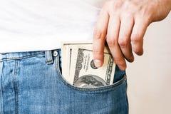 Man putting money in pocket Stock Photos