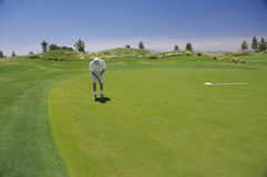 Man putting with mountains Royalty Free Stock Photos