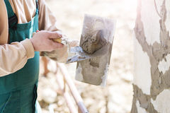 Man putting natural stones on a wall Royalty Free Stock Photos