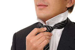 Man putting on necktie Stock Photos