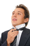 Man putting on necktie Stock Photo