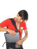 Man putting notebook in bag Royalty Free Stock Images