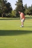 Man Putting On Golf Course Stock Photos