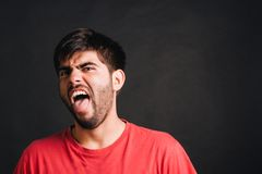 Man putting out his tongue Stock Photo