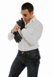 Man putting on a pair of gloves. Man putting on a pair of leather gloves stock photo
