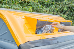 Man putting plastic waste in recycling bin Stock Photography
