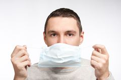 Man putting on protective mask Stock Images