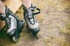 Man putting on roller skates Stock Photos