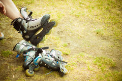 Man putting on roller skates Royalty Free Stock Images