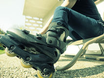 Man putting on roller skates Stock Photography