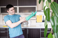 Man putting on rubber gloves Royalty Free Stock Images