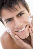 Man putting on shaving cream Stock Photography