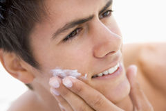 Man putting on shaving cream Stock Photo