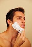 Man putting on shaving cream Royalty Free Stock Photo