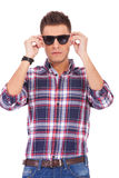Man putting sunglasses on Stock Photo