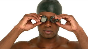 Man putting on swimming goggles stock footage