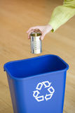 Man putting tin can into recycling bin, close-up of hand Stock Photo