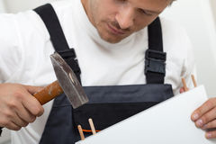 Man putting together self assembly furniture Royalty Free Stock Photos