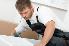 Man putting together self assembly furniture Stock Image