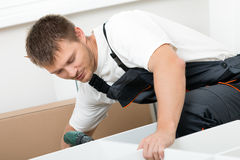 Man putting together self assembly furniture Royalty Free Stock Photography