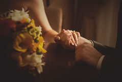 man putting wedding ring on woman hand Royalty Free Stock Photo