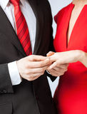 Man putting  wedding ring on woman hand Royalty Free Stock Photography