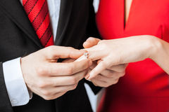 Man putting  wedding ring on woman hand Stock Photography