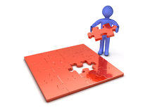 Man with Puzzle. 3d person making a puzzle Stock Image