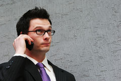 Man with a puzzled face. Smart businessman makes a phone call Stock Images