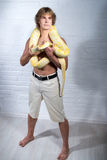Man with python. One naked person is holding wild albino python, brave man. Erotic emotional atmosphere, passion, desire, feeling, contact of brave human and Royalty Free Stock Images
