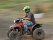 Man on a Quad Bike racing Royalty Free Stock Image