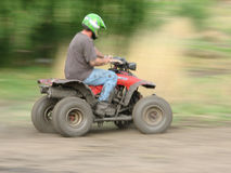 Man on a Quad Bike turning Royalty Free Stock Photo