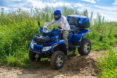 Man on quad Stock Images
