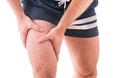 Man with quadriceps pain. Over white background Royalty Free Stock Photography