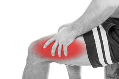 Man with quadriceps pain. Over white background Stock Photos