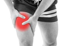 Man with quadriceps pain. Over white background Royalty Free Stock Photos