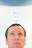 Man with question mark above his head Royalty Free Stock Images
