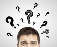 Man with question mark. Businessman with question mark on a white background royalty free stock photos