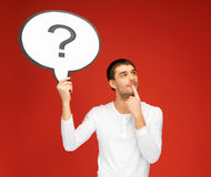 Man with question mark in text bubble Stock Images