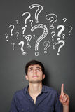 Man with question mark Stock Images
